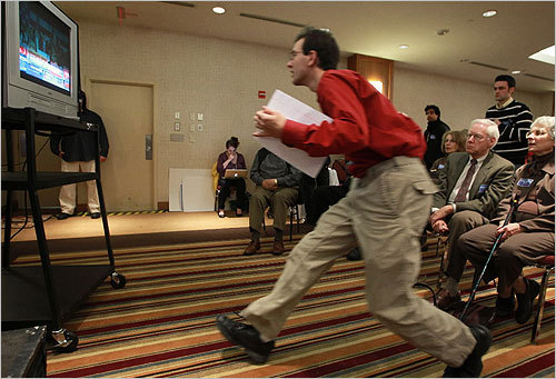 Nathan Beit-Aharon of Cambridge ran to a television monitor broadcasting national poll results as he and other supporters of Barney Frank awaited results at the Crown Plaza in Newton.