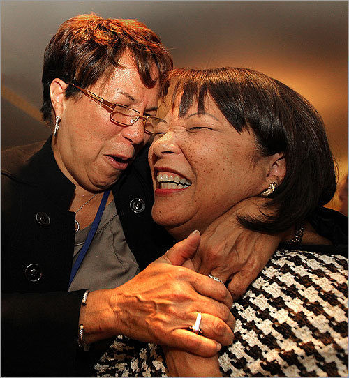 When NECN called the race, Diane Patrick, right, celebrated with her sister, Lynn Prime of Atlanta.