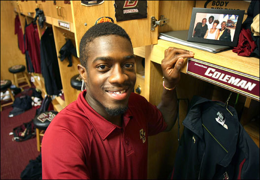 Boston College's Jonathan Coleman, a receiver on the football team, keeps a photo of his mother and grandparents on the top shelf of his locker.