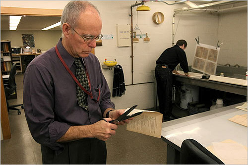 From left, book conservators Stuart Walker and Chris Letizia worked on the archive at the Boston Public Library's Rare Book room.