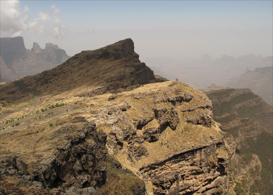 Trekkers are dwarfed against the Simiens' megalithic scenery, viewed from just below the Bua Heed Pass.