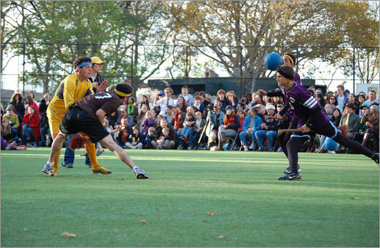 Tufts' seeker makes a play for the snitch while an Emerson beater goes in for a beat.
