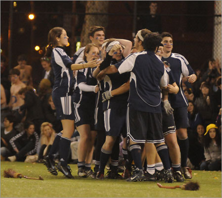 Middlebury celebrates its victory against Tufts in the final.