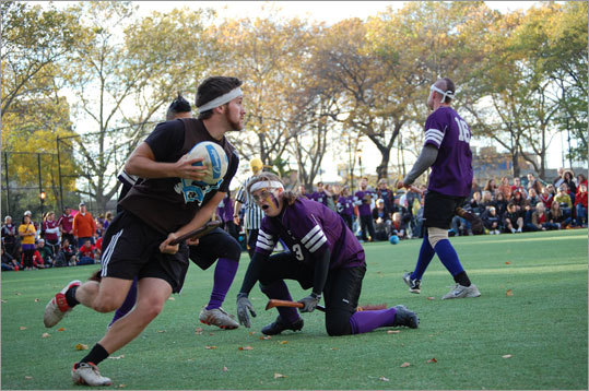 A Tufts chaser takes the quaffle back toward Emerson's goal.