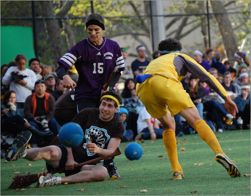 Tufts' seeker is hit with a bludger as the snitch runner (yellow) evades capture.
