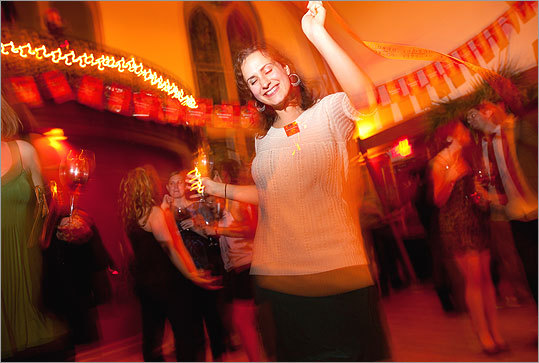 Stephanie Galaitsis of Somerville hit the dance floor at Villa Victoria. 'I have had Beaujolais Nouveau before and never really liked it,' Galaitsis said. 'But this is the perfect setting.'