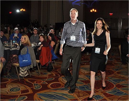 Adam Pemberton, managing director of Imagemark, walks with Susan Chaityn Lebovits of Boston University to accept the award for best project in the Educational Institution category, a microsite on BU's sustainability.