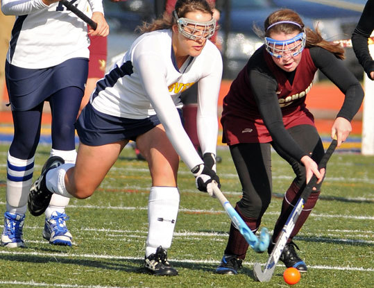 Andover's Meghan Morris reached in to steal the ball from Algonquin's Liz Holmes during the Division 1 State field hockey championship at Worcester State University Saturday November 20, 2010.