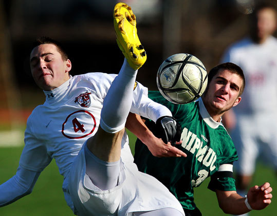 Concord-Carlisle's Bennet Simonton, left, battles Nipmuc's Kelly Rooney in the second half of the boys Division 2 state final at Worcester State University.