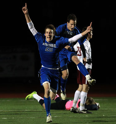The Dover-Sherborn boys' soccer program was last crowned state champions in 1992. Back then, Raiders' coach Joe Gruseck was an assistant coach and no player from his current roster was even born yet. Eighteen years later, this generation has a title to celebrate. Pictured: Dover-Sherborn's Sam Jordan (20) celebrating a game-winning goal in the state tournament. Read: Dover-Sherborn captures crown