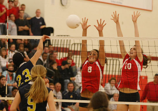 Barnstable reclaimed its title as the best Division 1 volleyball team in the state, shutting out Lincoln-Sudbury, 3-0, (25-11, 26-24, 25-17). Pictured: Barnstable's Kayle Crook, left, and Lynne Hibbard put up their defense against Bridgewater-Raynham. Read: Barnstable stymies Warriors