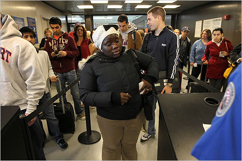 Passengers waited to pass security in Terminal B at Logan International Airport on Wednesday.