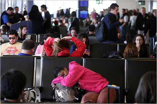 Passengers waited for their flights in Terminal B at Logan International Airport on Wednesday.