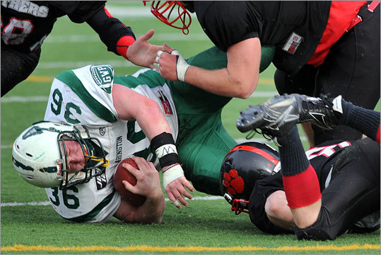 Abington's Paul Noble was brought down by Whitman-Hanson's Jerry Thompson (top right) and Jeff Bechen to end a long carry in the first half.