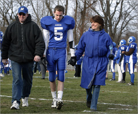 Methuen wide receiver Kevin Higgins (5) accompanied his parents Bob and Lianne Higgins during introductions of senior football players, band members and cheerleaders.