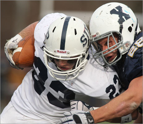 Xaverian's Chris Tamasi (right) tackled St John's Tyler Coppola in the second half.