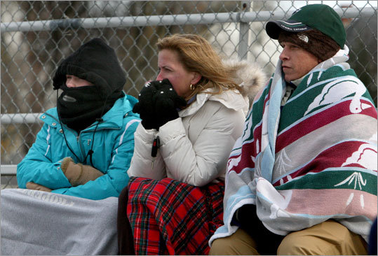 Bundled against the chilly wind were Sarah Sullivan and her parents, Joan and Ed Sullivan, as they waited for the kickoff. Their brother/son, Connor Sullivan, plays for Lowell Catholic.