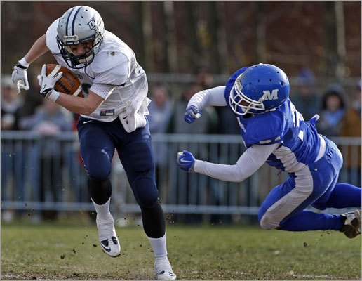 Dracut quarterback Matt Silva broke free of a first quarter tackle attempt by Methuen's Mike Harper (right) for some first quarter yardage.
