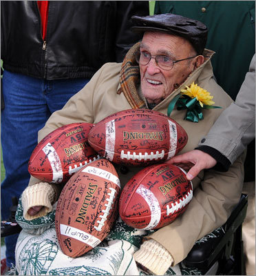 One of the oldest living players for Abington, Philip LaPointe, held autographed footballs during a pregame ceremony.