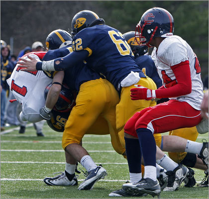 Central Catholic quarterback Ben Onett (11) was brought down by Andover's Mark Zavri (26), Ned Deane (48) and Connor Clancy (62). Onett was stopped short of a first down in the second half.