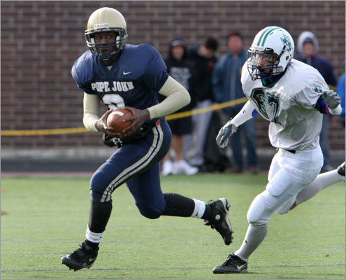 Pope John' s Malcolm Brown-Simpson (left) got away from Lowell Catholic's D.H. Yi after taking off on a run instead of punting in the first quarter. Pope John went on to defeat Lowell Catholic and earn a Division 4A playoff berth.