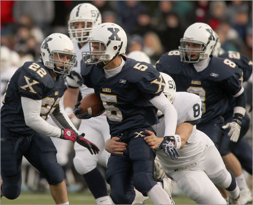 Xaverian's Mike Warren (5) looked for room to run vs. St. John's.