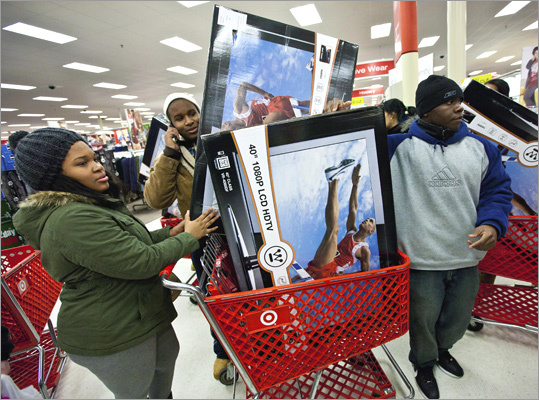 Boston area shoppers flocked to malls to get their hands on Black Friday deals. Some items, like these 40-inch Westinghouse 1080p LCD HDTVs for $2