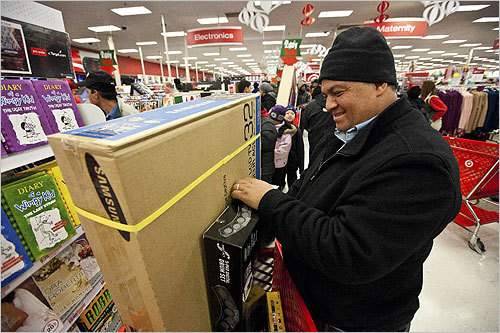 Jose Guzman, in town visiting family from Maryland, loaded his cart with a 32-inch Samsung TV during Black Friday at Target in Dorchester.