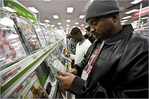 Roger Adams of Boston looked at Xbox games during Black Friday at Target in Dorchester.