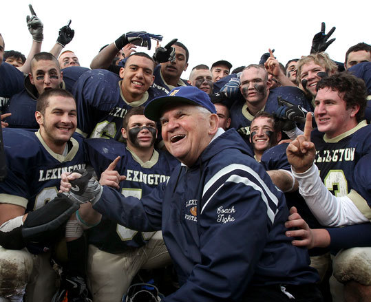 Lexington football coach Bill Tighe celebrated with his players after their Thanksgiving Day 14-0 win against Burlington. It was the final game for Tighe after a 60 year career as a coach, 36 of those years in Lexington.