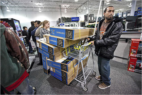 A dog is a man's best friend -- at least that's how the saying goes. But on Black Friday, canines everywhere faced their match: the TV. Men in search of TVs were part of the shopping crowd Friday morning. Among them was Manny Andrade, 25, shown here. He waited in line to buy nine 32-inch Samsung TVs at Best Buy in Dorchester. Scroll through to see photos of other guys and their new best friends. Some TV sales include Target's 40-inch Westinghouse 1080p LCD HDTV for $298, Wal-Mart's 32-inch Emerson 720p LCD for $198, and Best Buy's 42-inch Insignia 720p plasma for $369.99.