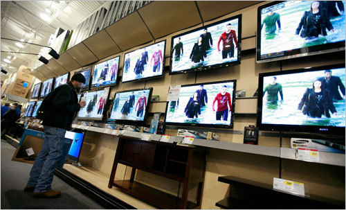 This customer was glued to the display of TVs at Best Buy in Fort Worth.