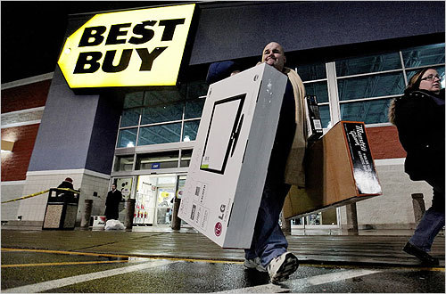 From left, Rich Ploude and wife, Kelley, left Best Buy with a TV after waiting in line since 2 a.m. in Dartmouth.