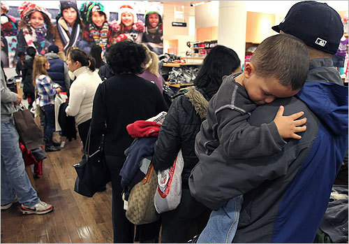 At the Cambridgeside Galleria mall in Cambridge, Junior Penera, 2, from Boston napped on his father's shoulder as they waited in a long line at GAP Kids.