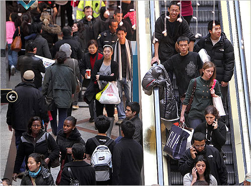 Shoppers jammed escalators and walkways at the Cambridgeside Galleria mall.
