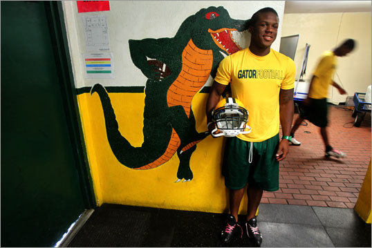 Kelvin Taylor, a soft-spoken, 5-foot-11-inch, 215-pound high school tailback, is the son of Patriots running back Fred Taylor.