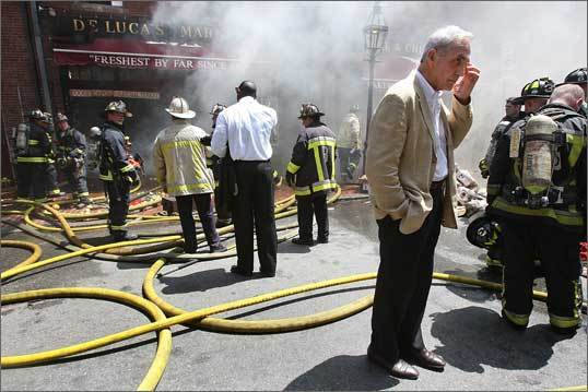 Last July, a four-alarm blaze broke out at DeLuca's Market on Charles Street, sending 75 firefighters out to battle the blaze in the Beacon Hill neighborhood. The owner of the market, Virgil Aiello, watched the firefighters worked.