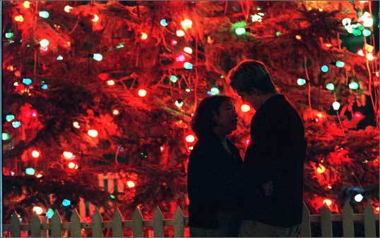 1998 Diane Nititham enjoys the lights from the Christmas tree on the Common along with her boyfriend, Johnathan Buya. They were visiting from Chicago.