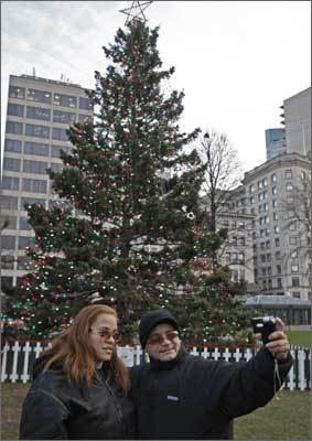 2009 Janet Pagan and Angel Martinez of Roxbury taking a picture of themselves in front of Boston's Christmas Tree in the Common on Dec. 14, 2009.