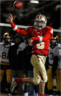 Everett quarterback Jonathan DiBiaso fired a first half pass while on the run to receiver Matt Costello. DiBiaso and the Crimson Tide beat Andover 21-0 Tuesday in the EMass semifinals at Manning Field in Lynn, earning a berth to the Division 1 Super Bowl against St. John's Prep at Gillette Stadium.
