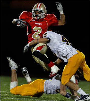 Everett's Manny Asprilla goes airborne while returning a first half punt before finally being brought down by Andover's Ned Deane.