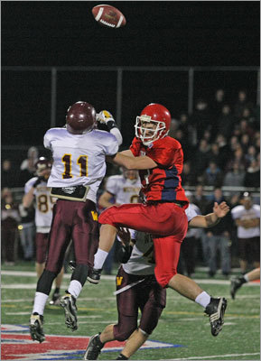 Weymouth's Shawn Whouley (11) tipped a pass and it's intercepted by Weymouth's Austin Colarusso (not pictured).