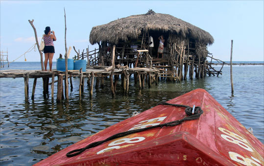 One of Treasure Beach's most popular bars rests atop stilts in the sea. A local fishing boat will whisk you to Floyd's Pelican Bar.