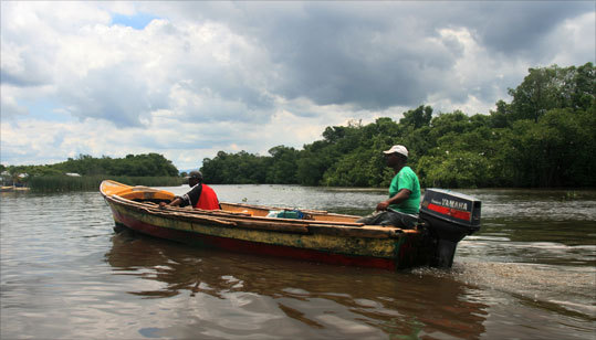 A typical fishing boat heads out to ply the waters of the Black River.