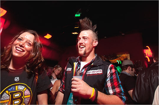 Mike Smith of Milford, Conn., rocked a month-old mustache and a four-hour-old mohawk at the gala. But, Smith said he's been invited to a friend's work party, 'where mohawks don't really fly.' 'I gotta get rid of it,' Smith said. 'The mustache is going, too. At left, Kristen DiCarlo of Boston. - Meet some Movember participants - Share your mustache photo