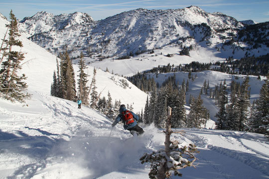 If you want a taste of the classic, crunchy Alta of the 70's, do laps on the Wildcat double. Since Snowbird and Alta have a shared pass now, you can ski all 4,700-acres in a day. This interconnected terrain rivals the Big Sky/Moonlight and Whistler/Blackcomb experiences. When you get tired and thirsty in Utah's high-altitude dry air, ski into Watson's Shelter for a linen table lunch at Collin's Grill.