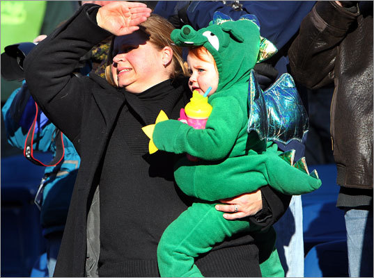 Michelle Taylor (left), of Pembroke, dressed her daughter Genevieve, 2, as the Duxbury mascot -- a green dragon.