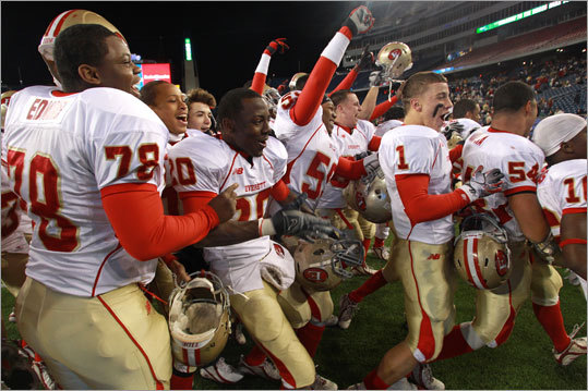 Everett players celebrated after defeating St. John's Prep 31-7 in the Division 1 Super Bowl at Gillette Stadium.