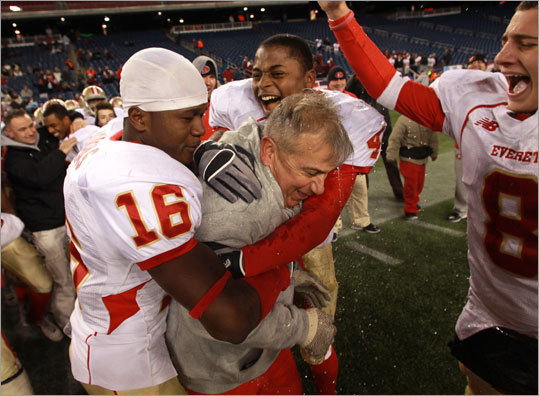 Everett coach John DiBiaso Jr. received a Gatorade shower after the final whistle in the Division 1 Super Bowl.