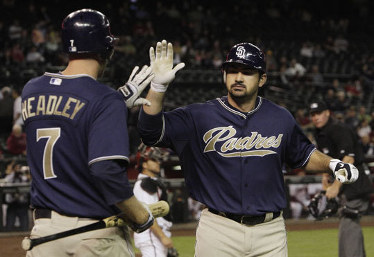 Adrian Gonzalez acquired in trade He'd been on the Red Sox' radar for a while, and Theo Epstein finally reeled in Padres first baseman Adrian Gonzalez before the 2011 season in exchange for minor leaguers Casey Kelly, Anthony Rizzo, and Reymond Fuentes. From 2007-2010, Gonzalez established himself as one of the most feared hitters in the National League, hitting more than 30 homers and slugging above .500 each year. The 28-year-old slugger led the majors with 213 hits and had 117 RBIs in his first season with the Red Sox.
